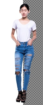 Full length body of 20s asian healthy woman wear white shirt blue jean stand on high heels shoes, skinny slim girl stand and put hand in pants pocket look at camera, studio white background isolated