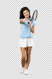 A full length shot of a young tennis player woman with thumbs up because something good has happened