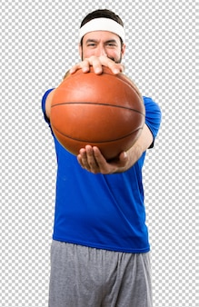 Funny sportsman with ball of basketball