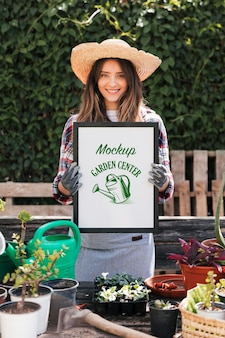 Gardener holding mock-up sign
