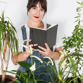 Gardening concept with woman reading book