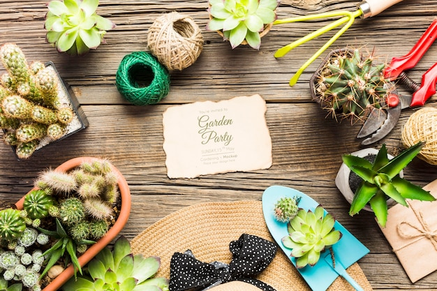 Gardening tools on wooden table top view