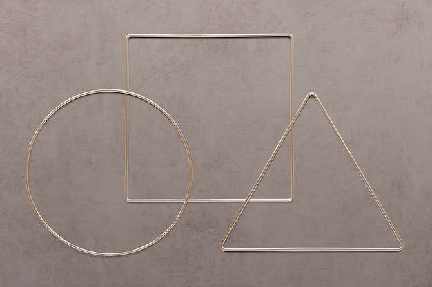 Geometric gold frames on brown concrete texture background