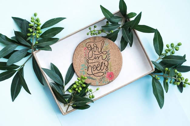 Gift box mockup with floral decoration