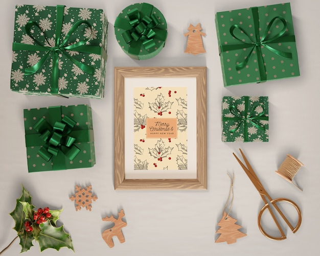Gifts wrapped in green paper around painting