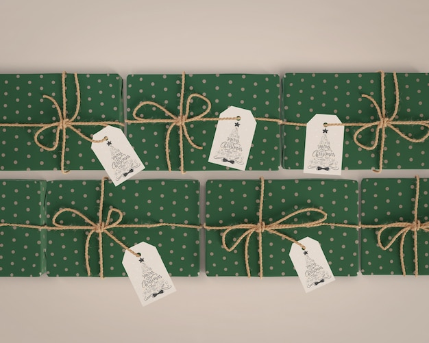 Gifts wrapped in green paper with tags