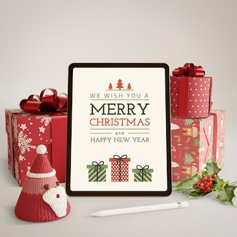 Gifts wrapped and tablet with christmas theme