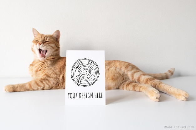 Ginger cat yawning with vertical postcard mockup