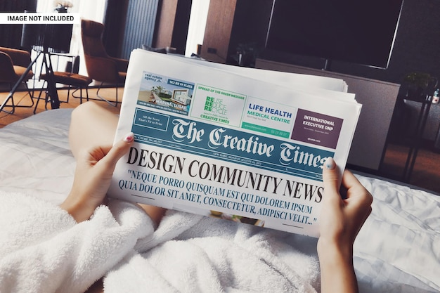 Girl on the bed reading the newspaper mockup