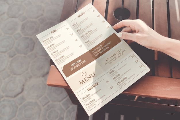 Girl holding a menu mockup