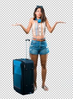 Girl traveling with her suitcase having doubts and with confuse face expression while rais