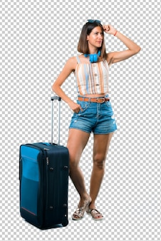 Girl traveling with her suitcase having doubts and with confuse face expression
