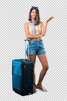 Girl traveling with her suitcase unhappy and frustrated with something. negative facial expression