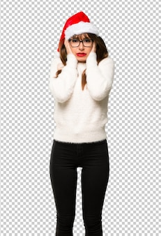 Girl with celebrating the christmas holidays covering ears with hands. frustrated expression