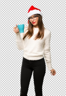 Girl with celebrating the christmas holidays holding hot coffee in takeaway paper cup