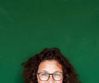 Girl with curly hair and glasses