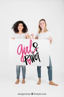 Girls holding whiteboard