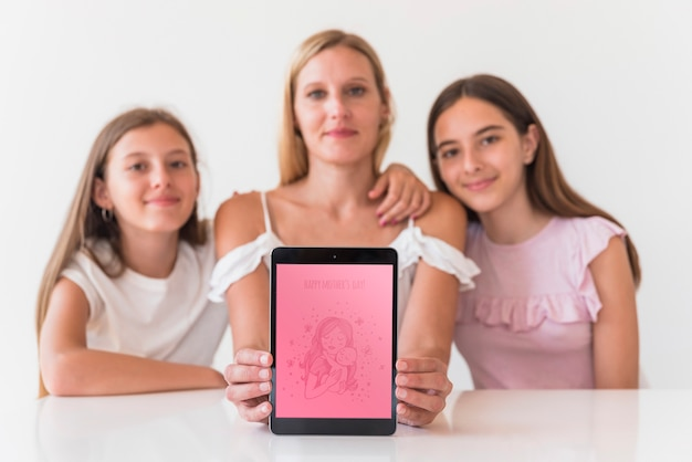 Girls presenting tablet mockup for mothers day