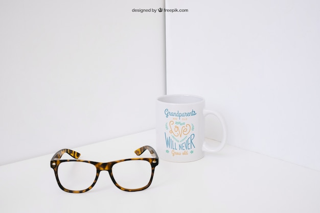 Glasses in front of mug