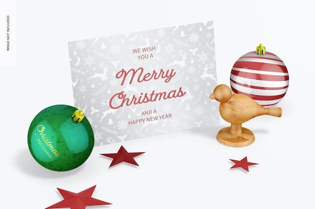 カードモックアップ付きの光沢のあるクリスマスボール