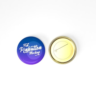 Glossy circle 3d metal gold pin button on flat surface