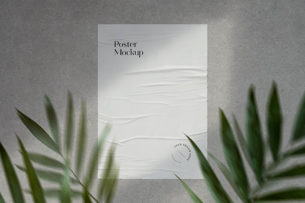 Glued poster mockup with shadows and greenery