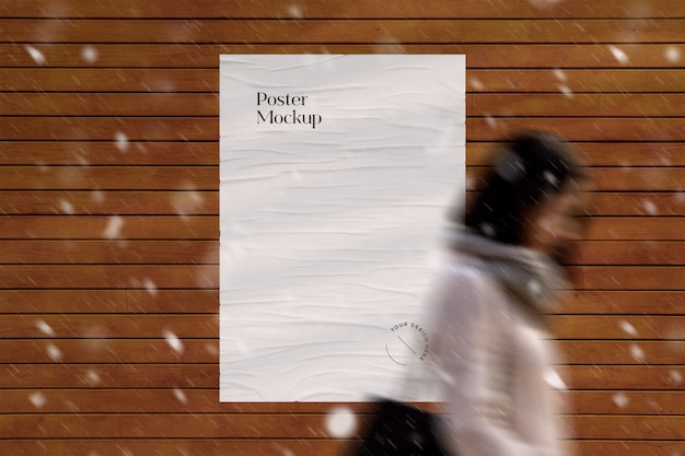 Glued street poster mockup with snow and rain