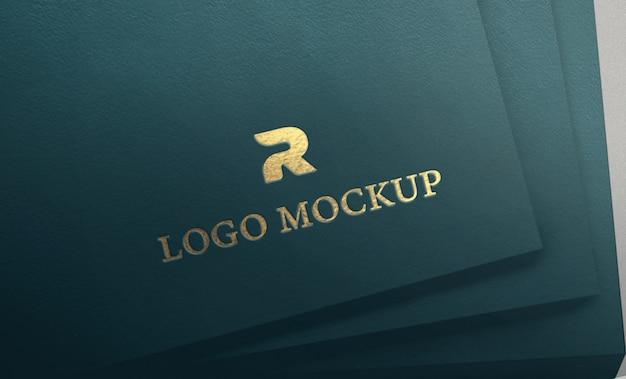 Gold debossed logo on cyan textured paper mockup