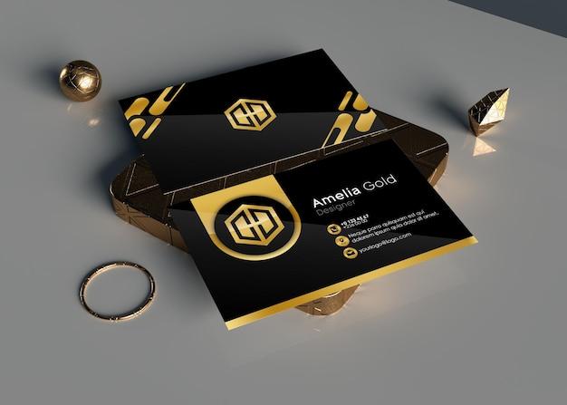 金の装飾と金のダイヤモンドの金の名刺のモックアップ