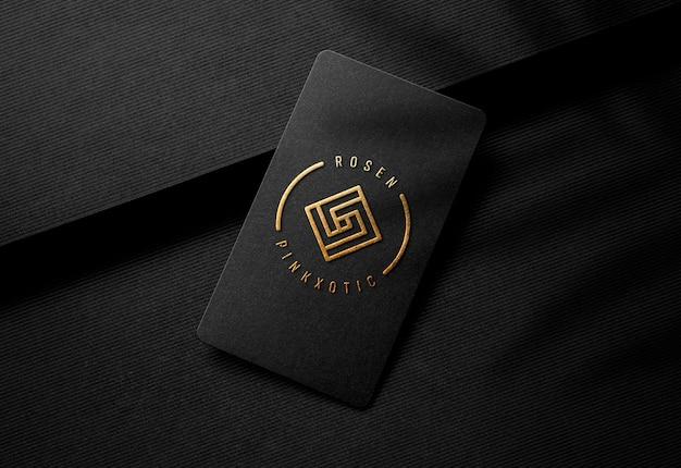 Gold embossed logo mockup on luxury black business card