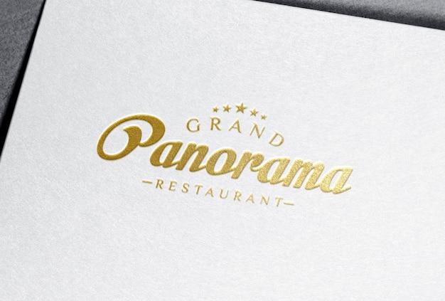 Gold foil logo mockup on white letterpress paper
