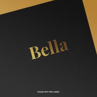 Gold foil stamped logo on a premium black paper mockup