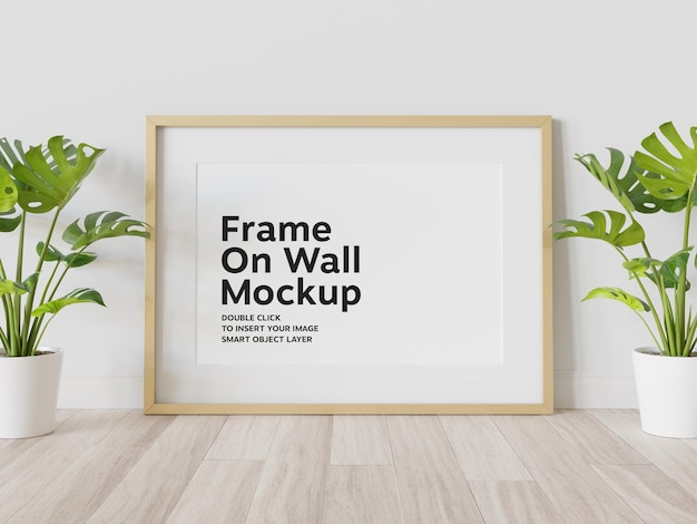 Gold frame leaning on wall mockup