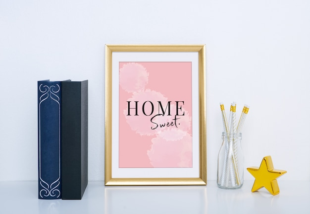 Gold frame mockup with vase and object for interior decoration.