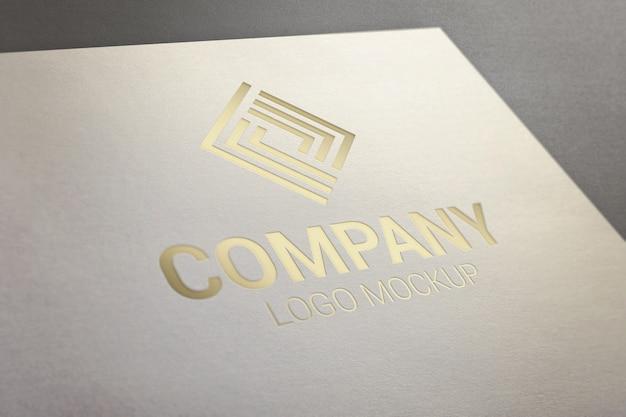 Gold glossy logo mockup on paper. Premium Psd