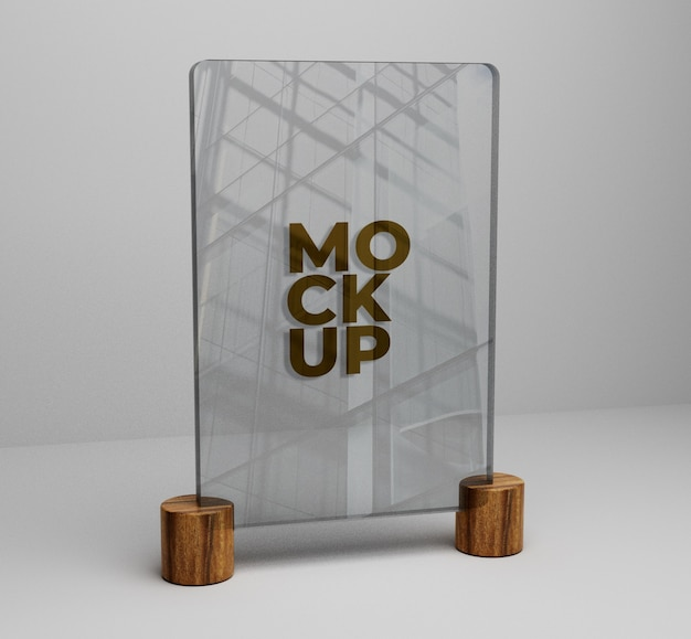 Gold logo mockup on glass on wooden background