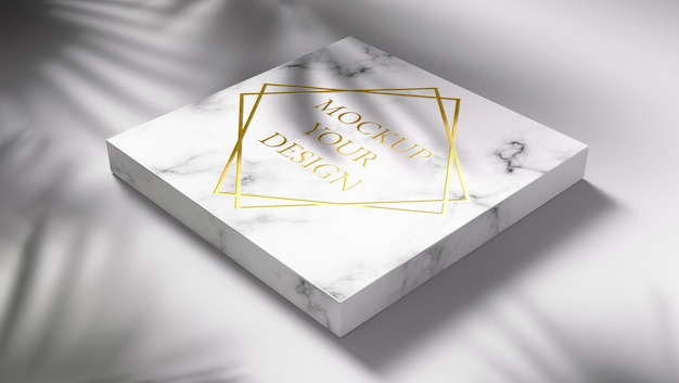 Gold logo mockup on marble with shadow leaves