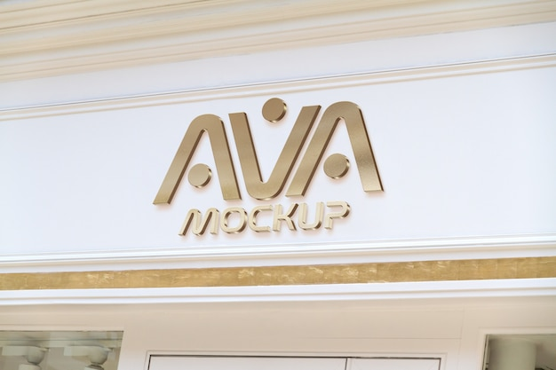 Gold logo on a storefront in street mockup