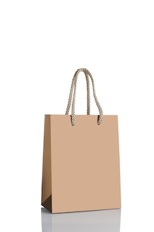 Gold paper shopping bag isolated.
