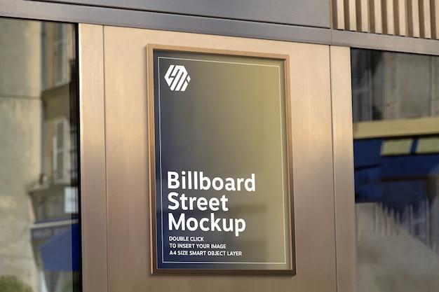 Golden billboard on storefront in street mockup