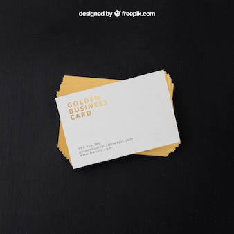 Golden business cards in psd format