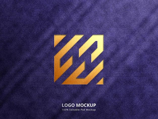 Golden emboss and deboss logo mockup with shadow overlay