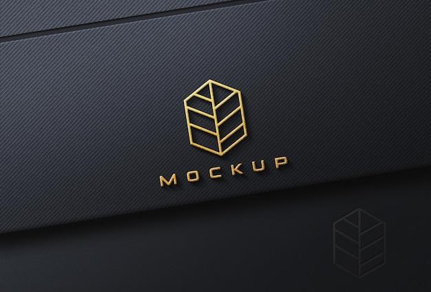 Golden embossed logo mockup on black fabric