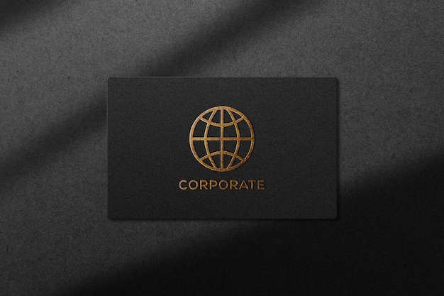 Golden embossed mockup logo on black paper texture