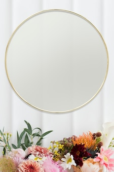 Golden floral frame on white wall