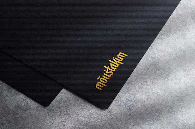 Golden foil logo embossed on black paper mockup