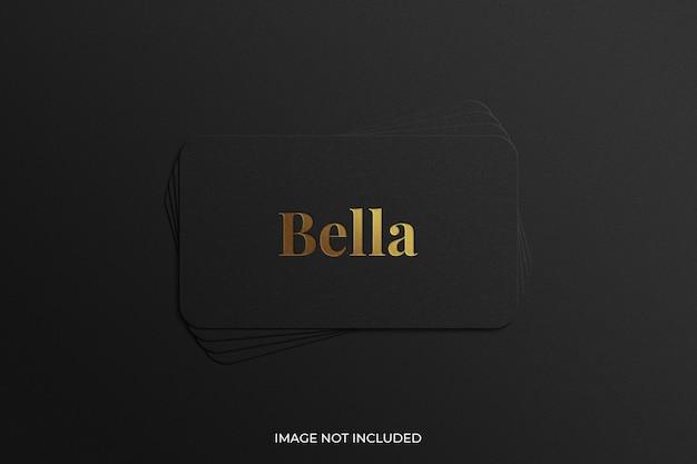 Golden foil stamped logo on black card stack mockup