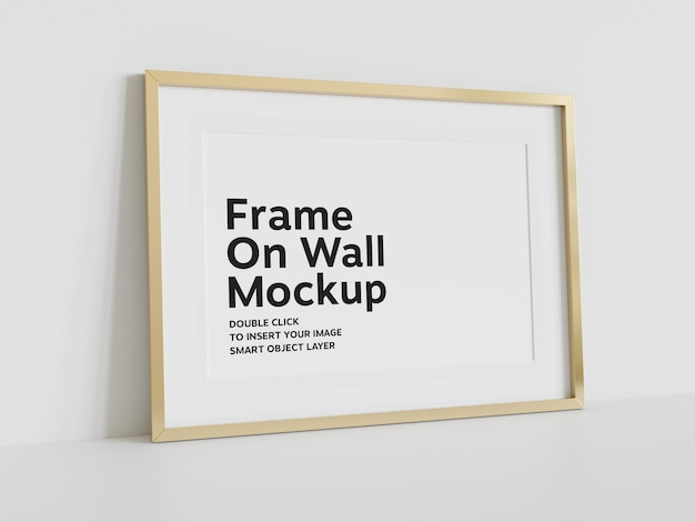 Golden frame leaning on wall mockup