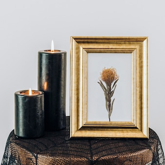 Golden frame mockup by the candles