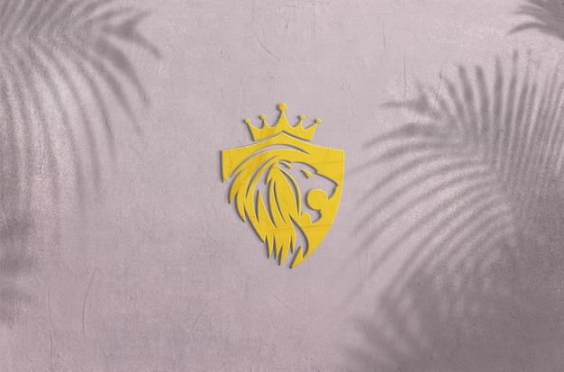 벽에 고립 된 황금 로고 모형 디자인